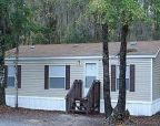 Foreclosed Home in Lake City 32025 SE SULTON LOOP - Property ID: 2232830131