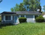 Foreclosed Home in Lansing 48911 DANBURY CROSSROAD ST - Property ID: 2677857259